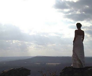 Bride looks over valley
